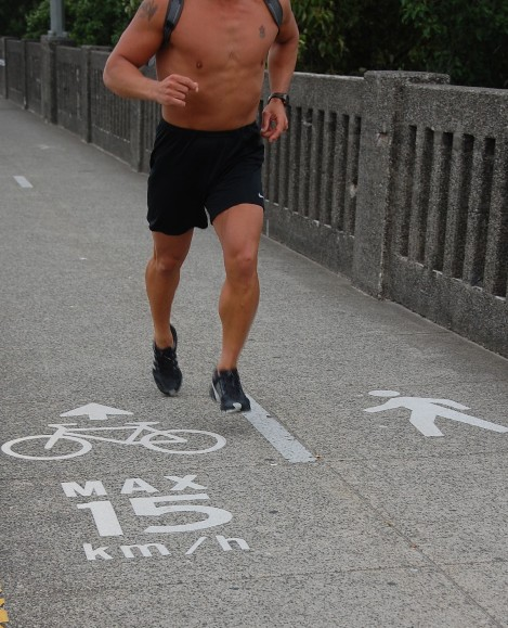 Runner on bike logo