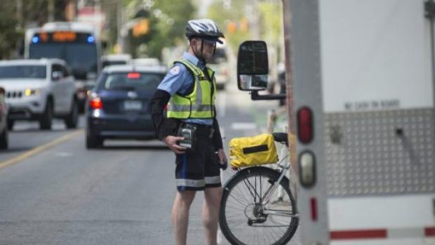 parking-enforcement-officer-kyle-ashley-toronto-cyclist