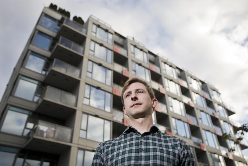 Daniel Olesiuk inside his Mount Pleasant apartment.