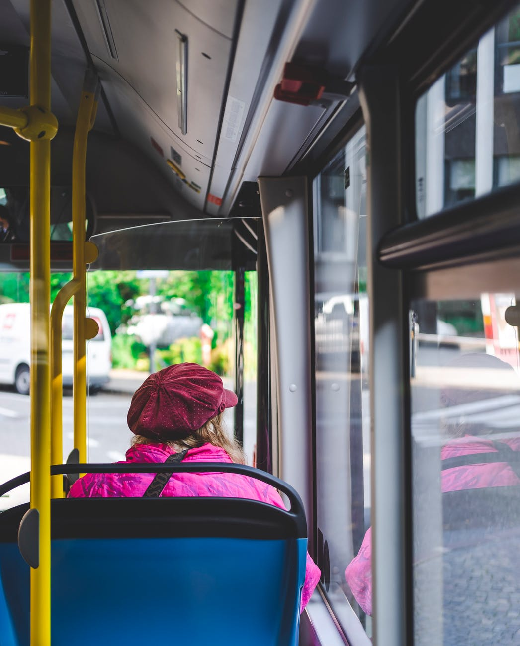 woman sitting inside bus